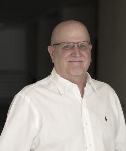 Headshot of mineral expert Richard Hughes